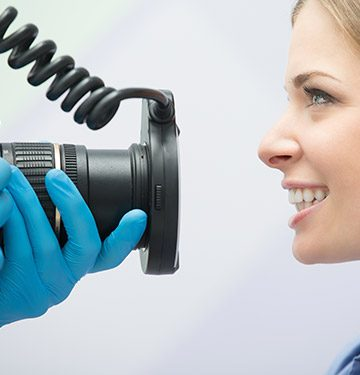 Dentist capturing picture of patient's smile