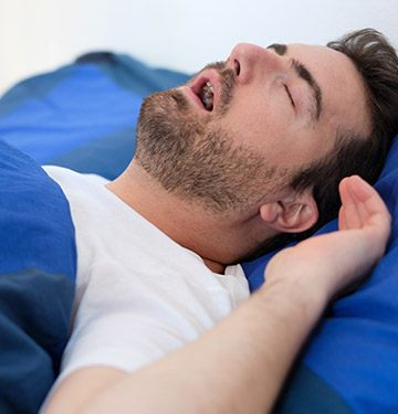 Man in bed snoring