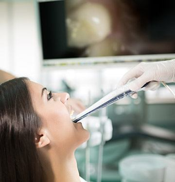 Dentist capturing images of patient's smile