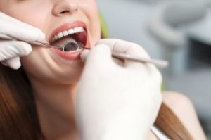 A smiling woman getting a dental exam